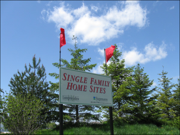 Residential Real Estate Sign With Flags Waukesah County