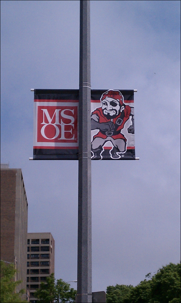 Pair Of Double Sided Street Pole Banners For A School In